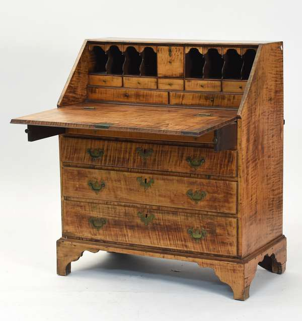 """Queen Anne transitional tiger maple slant lid desk with fitted interior, dovetailed top, four graduated drawers, old brass and on bracket foot base ca. 1760, 35""""W. x 41.5""""H. x 19""""D."""