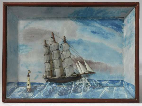 """American school 19th C. ships diorama depicting schooner and lighthouse in a whimsical manner, 23.5""""H. x 32.5""""W."""
