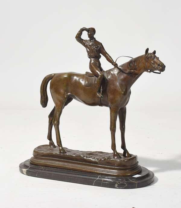 "Bronze sculpture signed P.J. Mene, jockey and racehorse, 11""W. x 11""H."