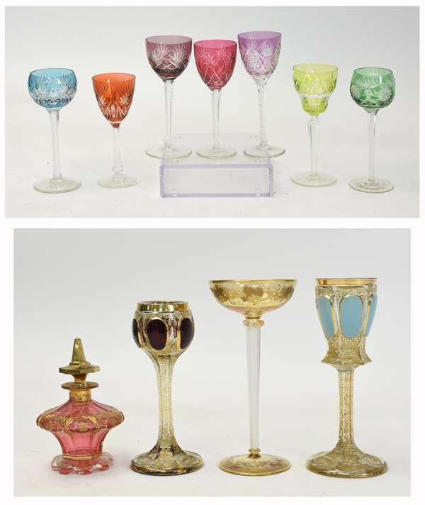 """Four pieces of Moser, three large wines, air twist stem example 10""""H., powder blue gadrooning 10"""", and cranberry gadrooning 9""""H., along with seven assorted colored Bohemian goblets, 7.5"""" to 8""""H. and   a small perfume 7""""H. (15,16, 26)"""