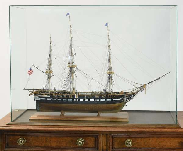 """Intricate large scale ship model in custom case, of the American frigate ship USS Constitution made by the Paul Anderson, 39""""L. x 14""""W. x 40""""H."""