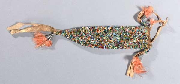 "Arapaho beaded knife sheath, sand pattern, 1920s, 8""H."