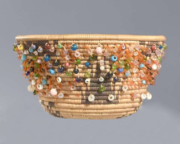 """Exceptional miniature Pomo beaded basket with red feather decoration, very finely woven, with quail topknot pattern, ca. 1900, 3.25""""Dia. x 2""""H."""