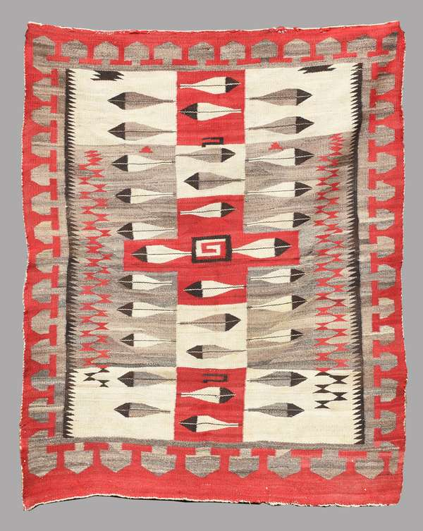 """Pictorial weaving with feather motif, ca. 1905-1915, 54"""" x 72"""". Eagle and turkey feathers frequently appear with Yeis and other deities in sand paintings. Illustrated in """"Navajo Pictorial Weavings, 1880-1950"""" by Tyrone Campbell and Joel and Kate Kopp, 1991, pg 21."""
