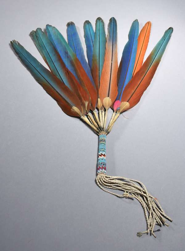 """Peyote fan with Macaw feathers, beadwork, and silver charms, ca. 1917, 17""""H."""