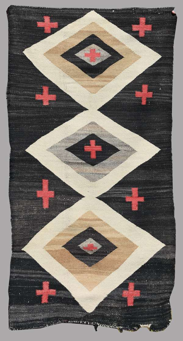 """Turn-of-the-century Navajo child's blanket, three diamonds with red crosses on black field, 26.5"""" x 52.5"""" (Original museum collection)"""
