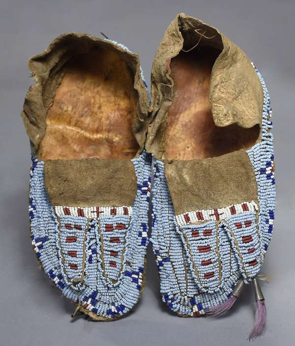 """Arapahoe child's fully-beaded sinew-sewn moccasins, ca.1890 bifurcated beaded tongues, with light blue, navy, white, and red beading, 7.5""""L"""