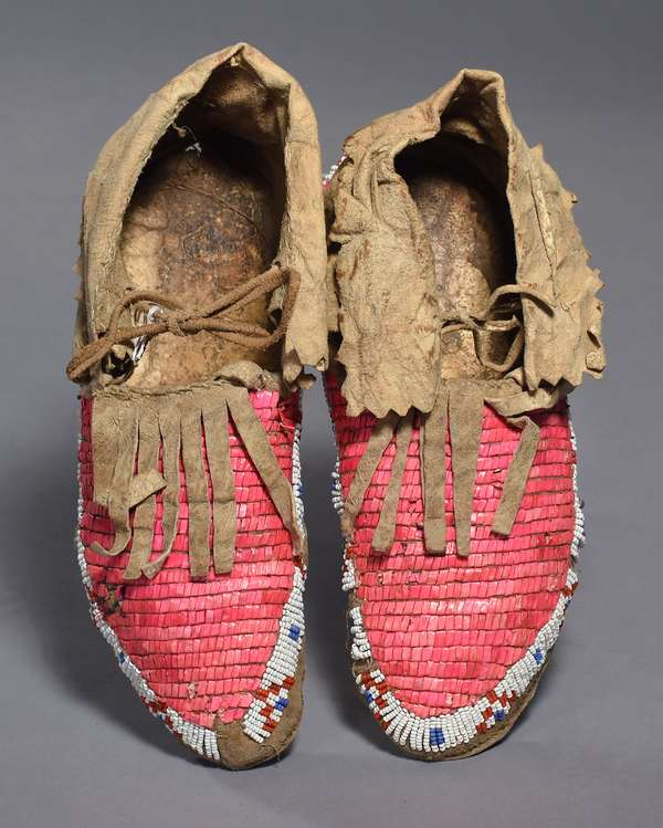 """Sioux sinew-sewn moccasins, quilled with pink dyed porcupine quills and red, white and blue beadwork, 10""""L."""