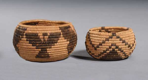"""Two miniature 19th C. Southwest woven baskets, one example with two butterflies and two Thunderbirds, 3.5"""" Dia. x 2""""H.; second example with star flower design, 3""""Dia. x 1.4""""H."""