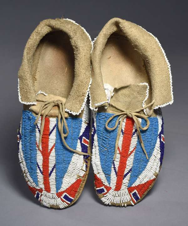 """Pair of Sioux men's fully-beaded moccasins, sinew-sewn, ca. 1900, 12""""L. (Original museum collection)"""