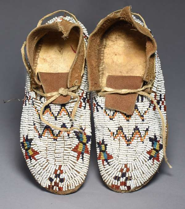 """Cheyenne child's fully-beaded moccasins, ca. 1890-1900, 8""""L., sinew sewn, with white, red, blue, yellow, turquoise beads"""