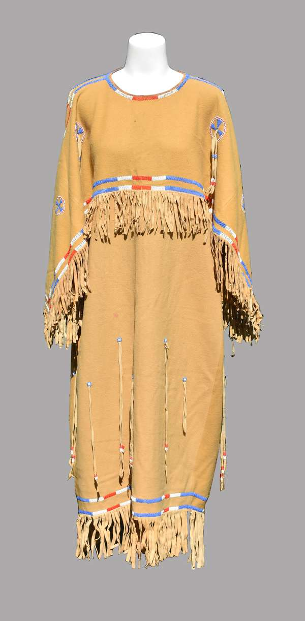 """Cheyenne ladies tan wool dress with hide fringe, and red, white and blue beading, 1920s/30s, minimal staining, 26""""W. x 42""""H."""