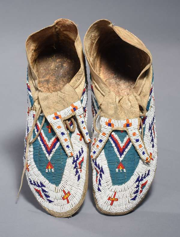 """Sioux fully-beaded sinew-sewn moccasins, lazy stitch, ca. 1900, with added rubber soles, 12""""L."""
