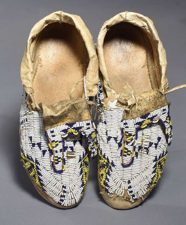 """Sioux fully-beaded men's moccasins, with blue, yellow and white beading, resoled, sinew sewn, ca. 1900, """"bifurcated beaded tongues"""", 11""""L., partial bead loss left front"""