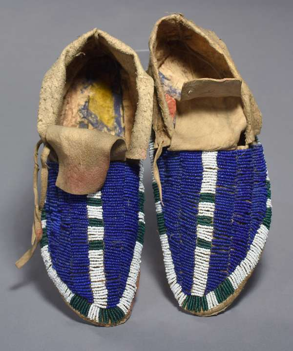 """Plains fully-beaded moccasins, """"cloven-toe"""" beading in blue, green and white, 10""""L."""