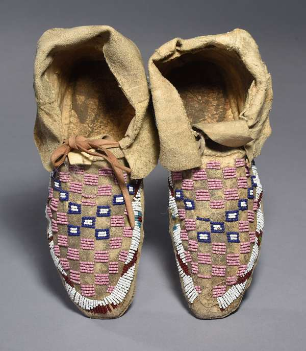 """Sioux partially beaded checkerboard design moccasins, sinew-sewn, ca. 1900, 10.5""""L."""