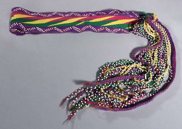 """Early 20th C. Huron/ Osage woven yarn sash with white pony bead decoration and long beaded fringe; green, yellow, purple, and pink yarns, 82""""L."""