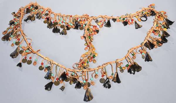 """Dance sash with dewclaw, trade beads, Indian head pennies, and seeds with carved spiders and insect decoration, 68""""L"""