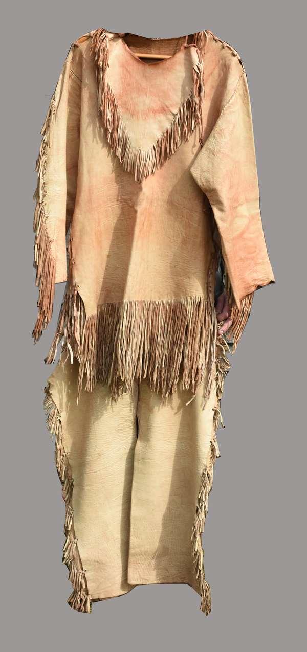 "Three-piece Woodlands buckskin costume, including shirt, 21"" wide at shoulders, 27""H.; leggings, and triangular neckpiece, 1940s"