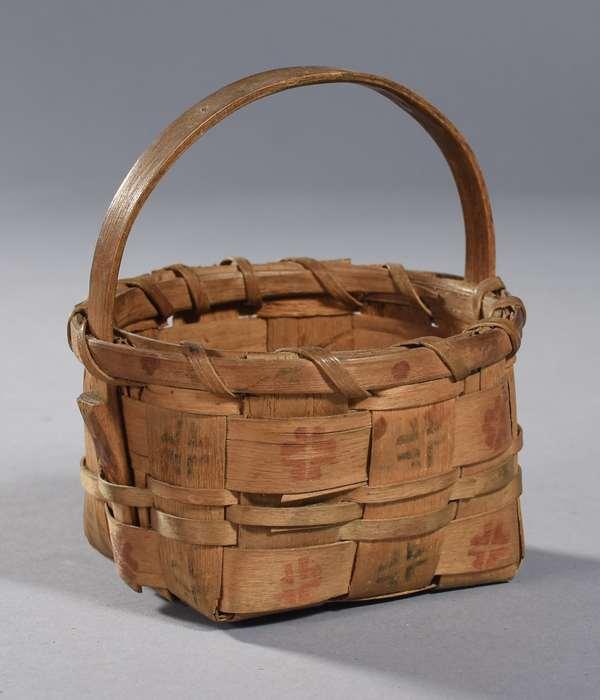 "Adorable miniature Woodlands handled potato stamp splint basket, 19th C. 6""H. x 4""Dia."