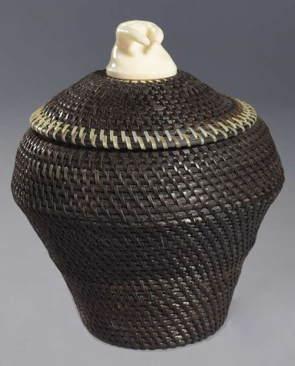 """Inuit baleen basket, signed Harry Hank, of Point Barrow AK, 2000, with finial in the form of a walrus head, 6""""H. x 5""""W."""