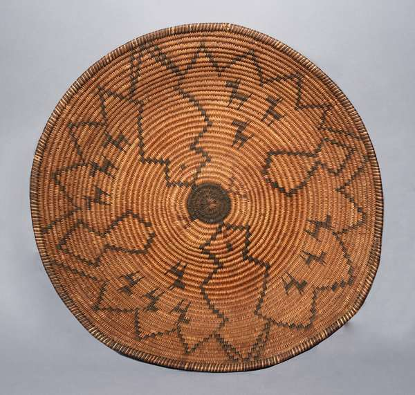 """Large Western Apache woven basketry tray, with twelve animals, mountains, and red bud decoration, minimal stitch loss, ca. 1900, 19.5""""Dia. x 4""""H."""