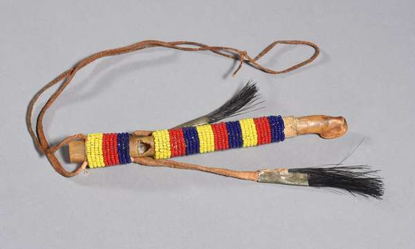 """Sioux sundance whistle, bone with red, yellow and blue beading and horse hair metal cone decoration, 6.75""""L"""