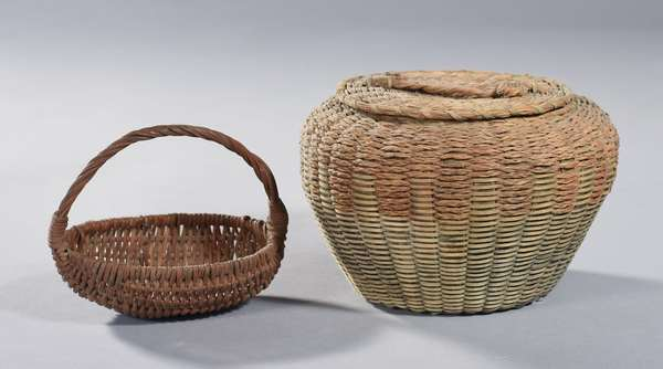 """Two Eastern baskets: Maine Woodlands sweetgrass painted lidded basket, 7.5"""" Dia. x 5.5""""H., with a miniature painted handled basket, 5.5""""L."""