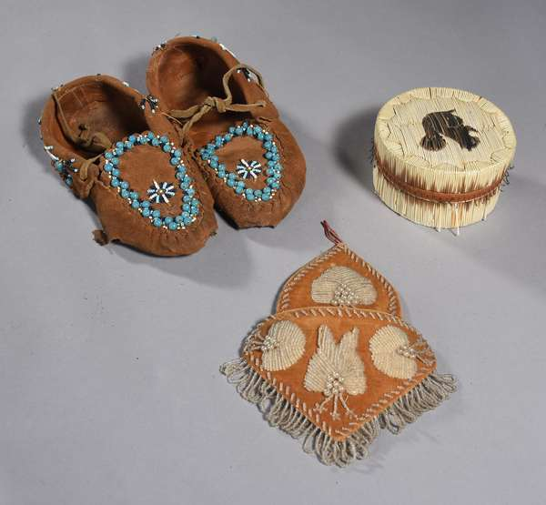 """Woodlands lot: pair of small blue beaded moccasins (worn soles), 9""""L. ; with a birchbark porcupine quilled box with squirrel, 4""""Dia., with a beaded Huron wall pocket, 7""""L."""