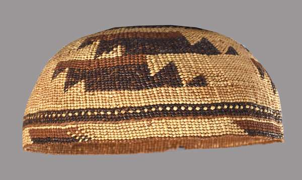 """Hupa basketry hat, ca. 1900, finely woven, polychrome with geometric design, 7""""Dia. x 3""""H."""
