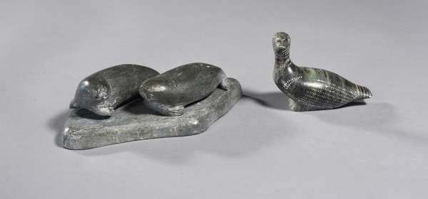 """Two Inuit carved soapstone figurines: water bird, 3""""L., with two seals on a rock, 4""""L. x 5""""W."""