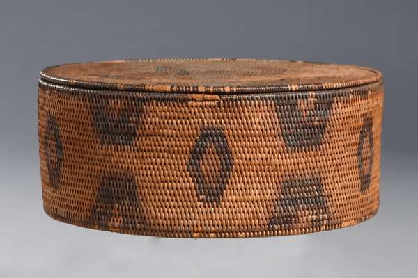 "Early Eskimo round lidded basket with geometric decoration, 7.5""Dia. x 3""H."