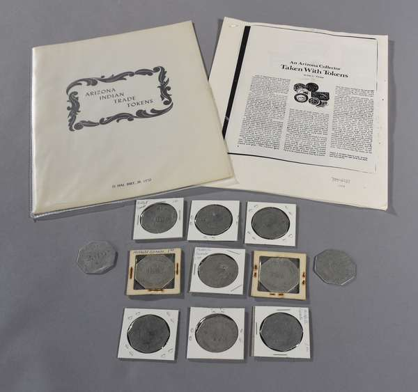 """Lot of Indian trade tokens, eleven $1 J. L. Hubbell, Ganado, 1900s, along with """"Arizona Indian Trade Tokens"""" reference book, by Hal Birt (out of print), and other Trade Tokens informational article"""