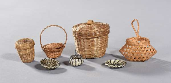"""Lot of seven miniature baskets: three Popago woven horsehair baskets, one with lid 0.5""""H.; two Woodlands lidded baskets, 2""""and 1""""H. and two others"""