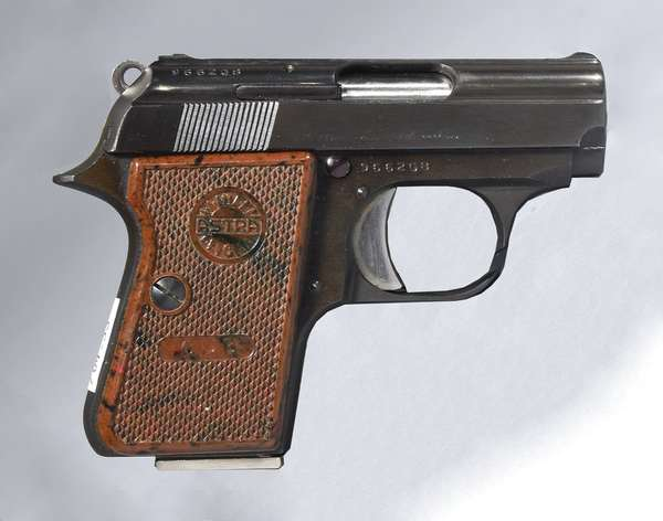 Small Astra hand gun, model Cub, with holster and magazine (T-45)