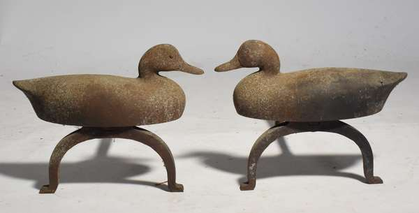 Pair of cast iron duck form andirons