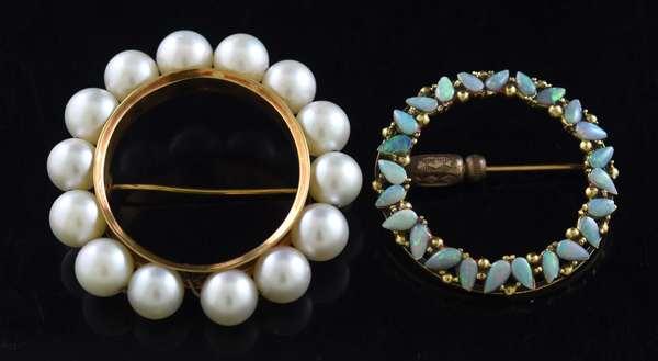 Two gold circular pins (320-29)