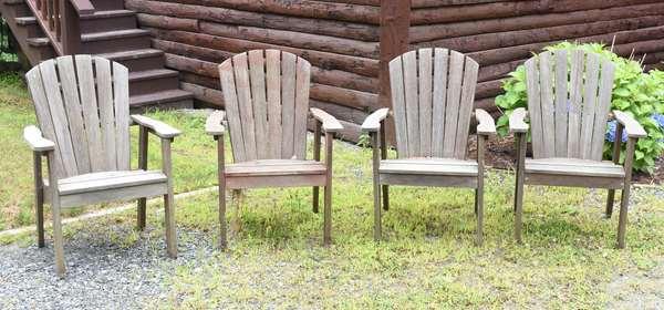 Four Adirondack chairs (44-591)