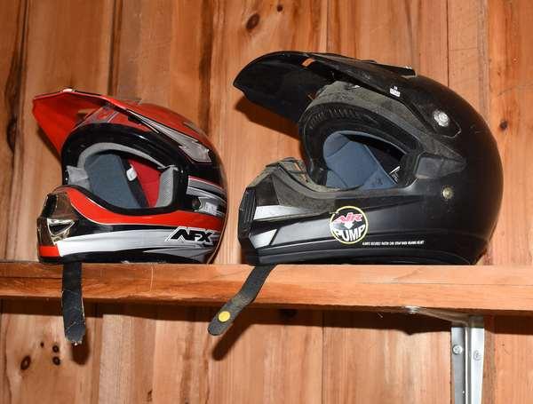Two motorcycle/ dirt bike helmets