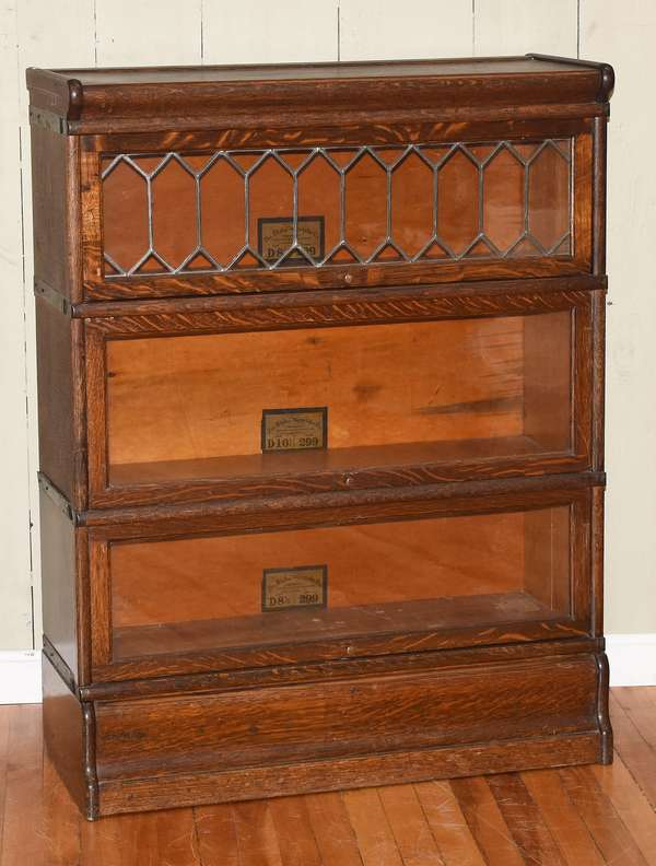 """Three section oak stacking bookcase, leaded door top by Globe Wernicke, 34""""W. x 43""""H. x 12""""D. (464-11)"""