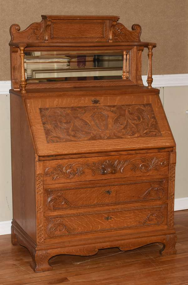 "Antique carved oak desk with beveled mirror top shell carved pull, 34""W. x 56""H. x 20""D., ca.1910 (464-20)"