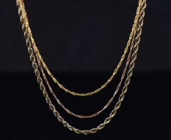 Three, 24 in. 14kt gold chains, two yellow, one rose, 7.0 grams.