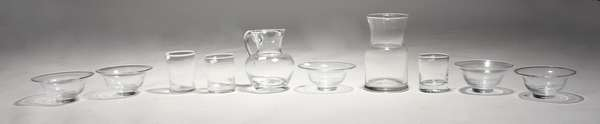 "Ten pieces of Simon Pearce glassware, incl. pitcher 6.5""H, cups, bowls, and vase"