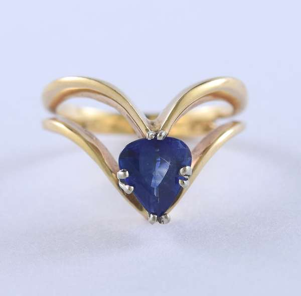 Lady's 14k yellow gold open chevron design ring set with a pear shape blue sapphire, 1.20 ctw, size 6, 3.88 grams