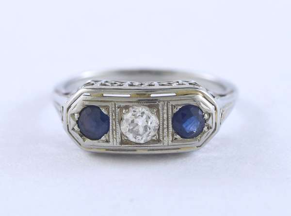 Lady's 14k white gold filigree ring set with two round blue sapphires and one round diamond, 2.64 grams, size 5.5