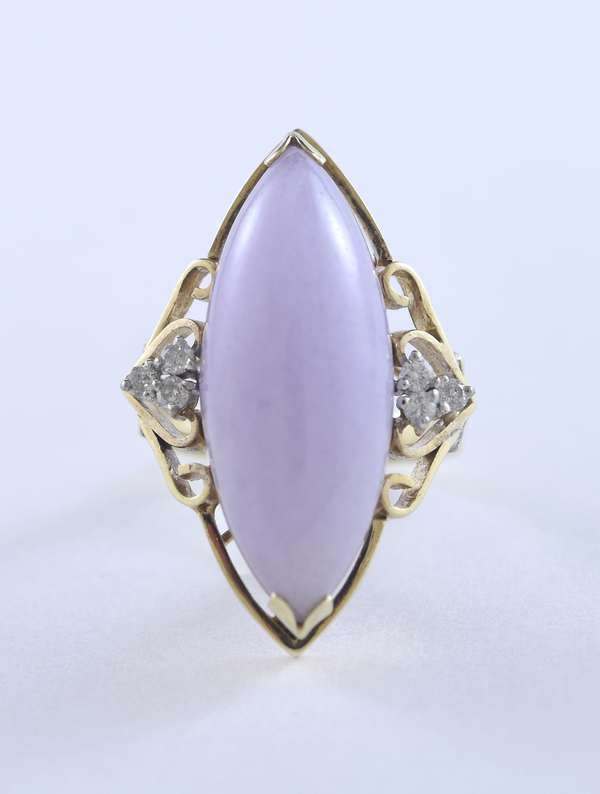 Lady's oblong lavender jade ring set in a lovely 14k yellow gold, accented with three diamonds on each side, size 6, 9.8 grams