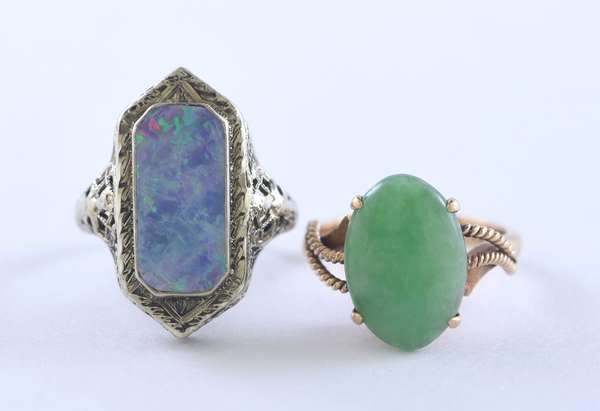 Two rings: a 14k white gold filigree ring set with a rectangular shape opal, size 5.5, along with a 14k yellow gold oval green jade cabochon, size 4.5, 6.6 grams