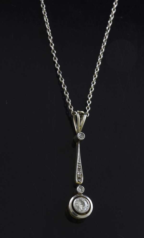 14kt white gold (tested) diamond pendant and chain, approx. .18 ct. tw. Old European cut diamonds, 18 inches long, 2.6 grams.