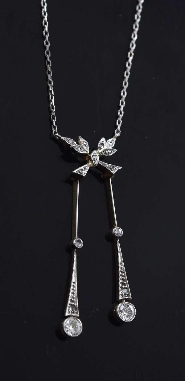 14kt white gold (tested) diamond lavalier necklace w/ approx. .35 ct. tw. Old European and rose cut diamonds, 18 inches long, 4.0 grams.
