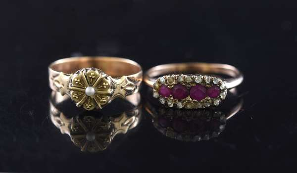 Two 14kt yellow gold rings: ruby and rose cut diamond cluster ring, sz. 6 3/4 and round w/ seed pearl, sz/ 6, 3.2 grams.